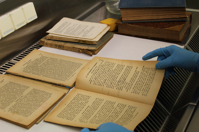 Cleaning of contaminated archival material